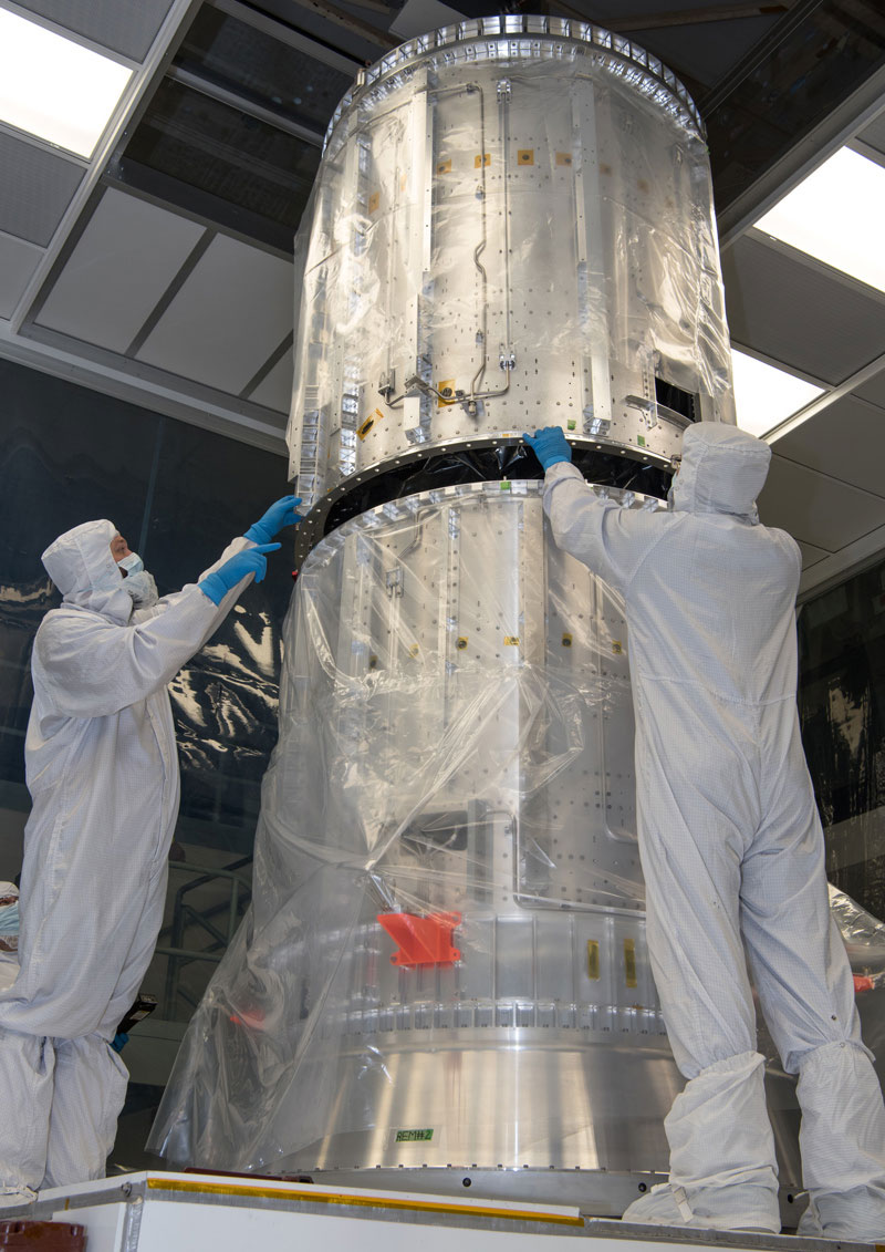Technicians at NASA's Goddard Space Flight Center check the fit of the cylinders of the propulsion module core of NASA's Europa Clipper spacecraft on Oct. 15, 2020.