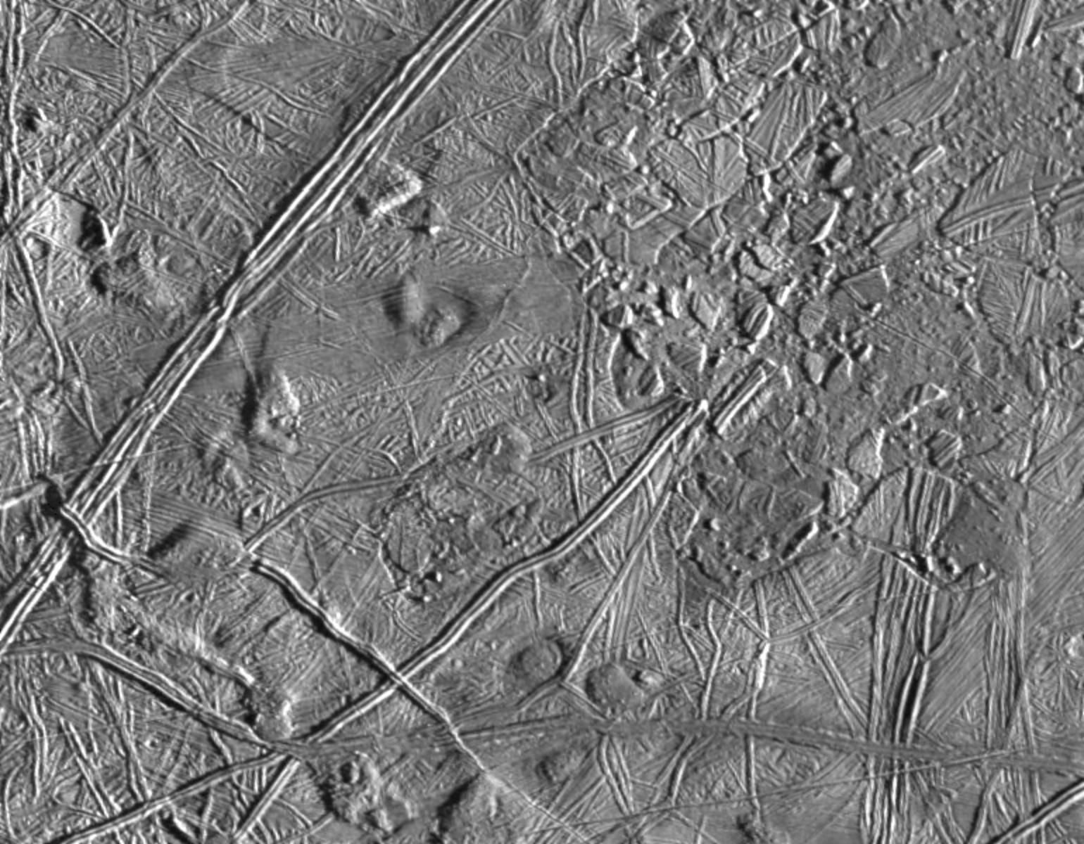 black and white view of complex terrain on an icy surface
