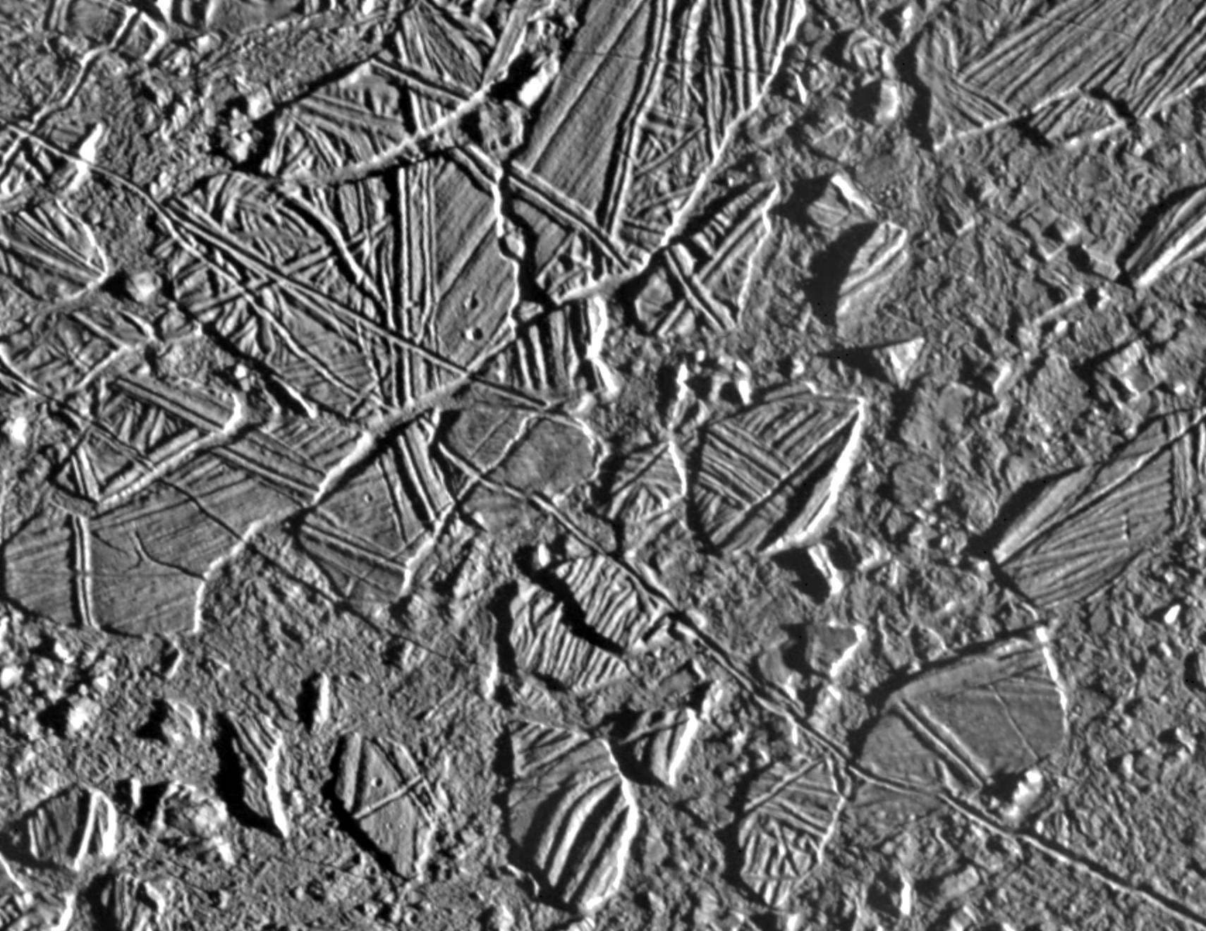 black and white view of rough terrain on an icy surface