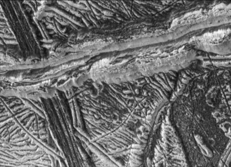 black and white view of ridges and rough terrain on an icy surface