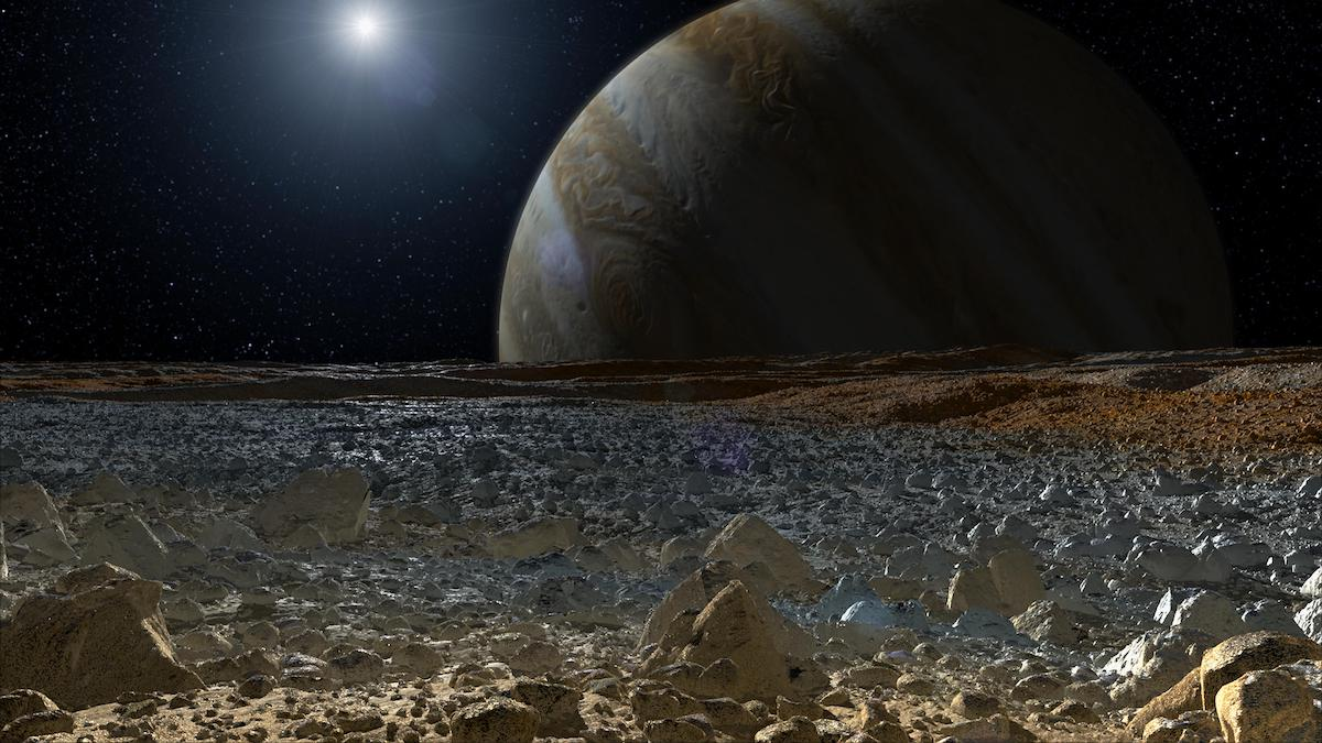field of icy boulders with jupiter rising over the horizon