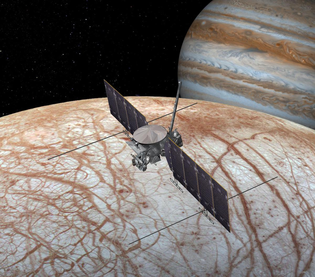 spacecraft over surface of Europa with Jupiter in background