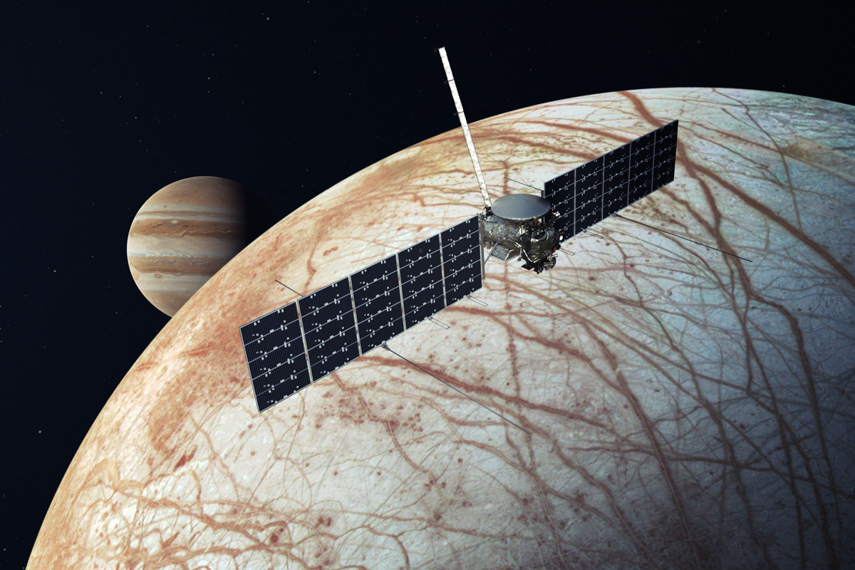 artist's rendering of the Europa Clipper spacecraft with Europa and Jupiter in the background