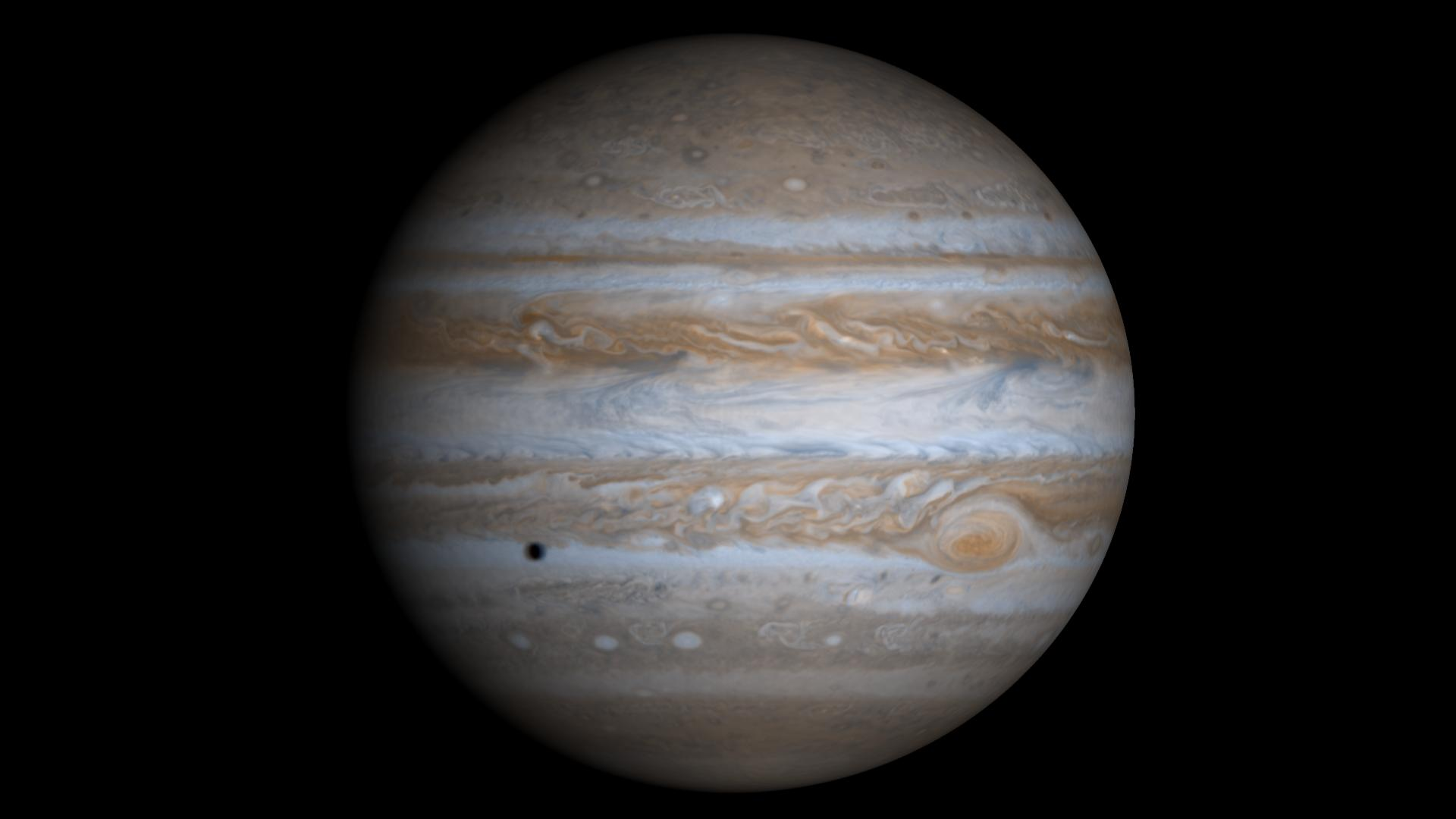 full disc of jupiter with small shadow on cloud tops