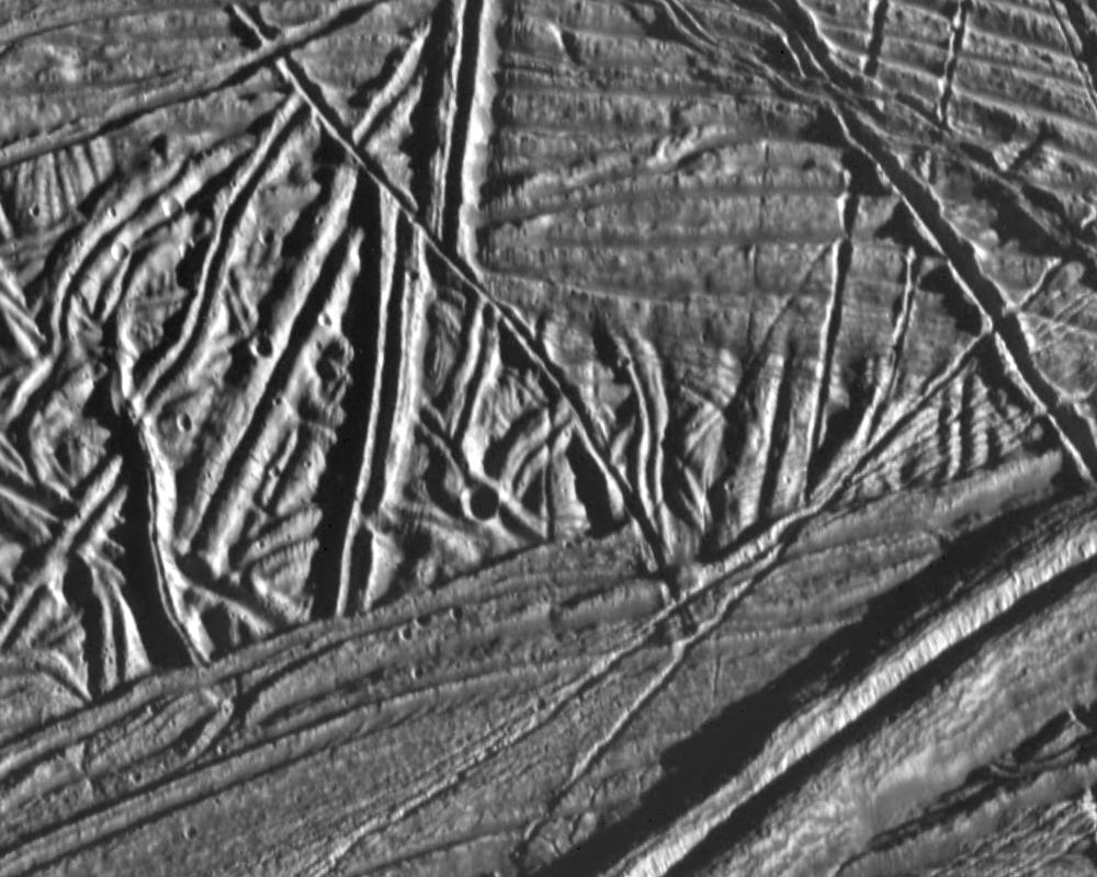Various linear ridges on Europa as seen from orbit.